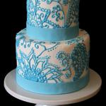 Teal Henna Design pops against white fondant