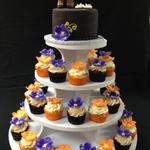 Cowboy Boots and Flip Flop Keepsake Cake Toppers on top of a Tower of Cupcakes with handmade Flowers